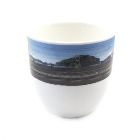 thee-koffiemok met een snapshot van het NL landschap
