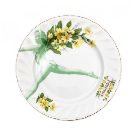 Gebaksbordje met gele bloemen en een springend model