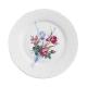 Dinerbord met bloemen en een sportieve dame